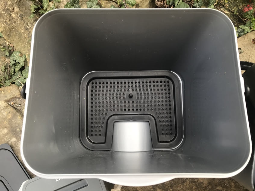 inside of Bokashi bin showing drainage insert which separates solid product from liquid food